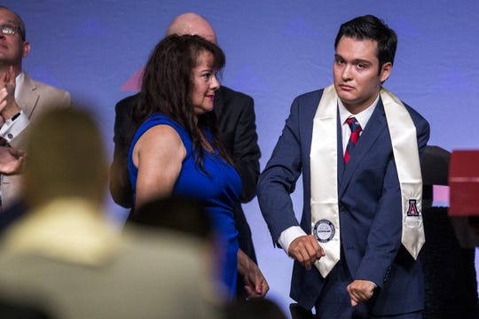 Hermelinda Bristol watches as her son, Jeffrey, 24, is recognized during University of Arizona's Eller College of Management convocation on  May 11, 2019.
