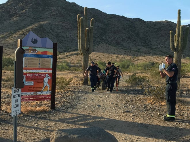 A Phoenix Fire Department technical rescue team transports unconscious male hiker to parking lot after the man was found unresponsive by other hikers on the trail.