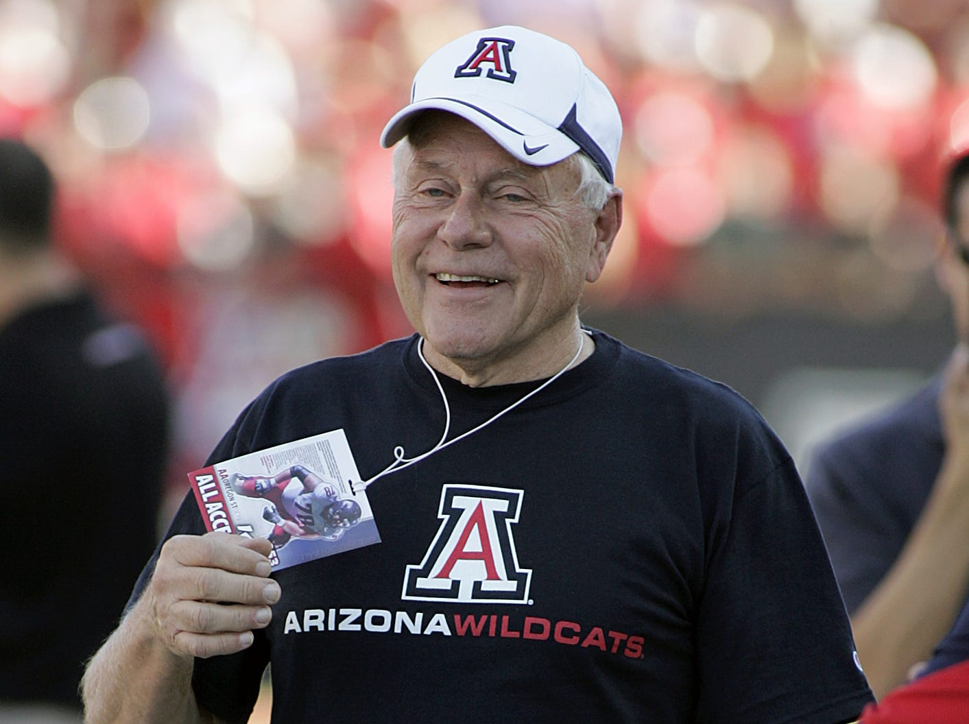 Former Arizona football head coach Dick Tomey, back in Arizona  Stadium for the first time since 2000, jokes on the sidelines before a game against Oregon State on Oct. 9, 2010.