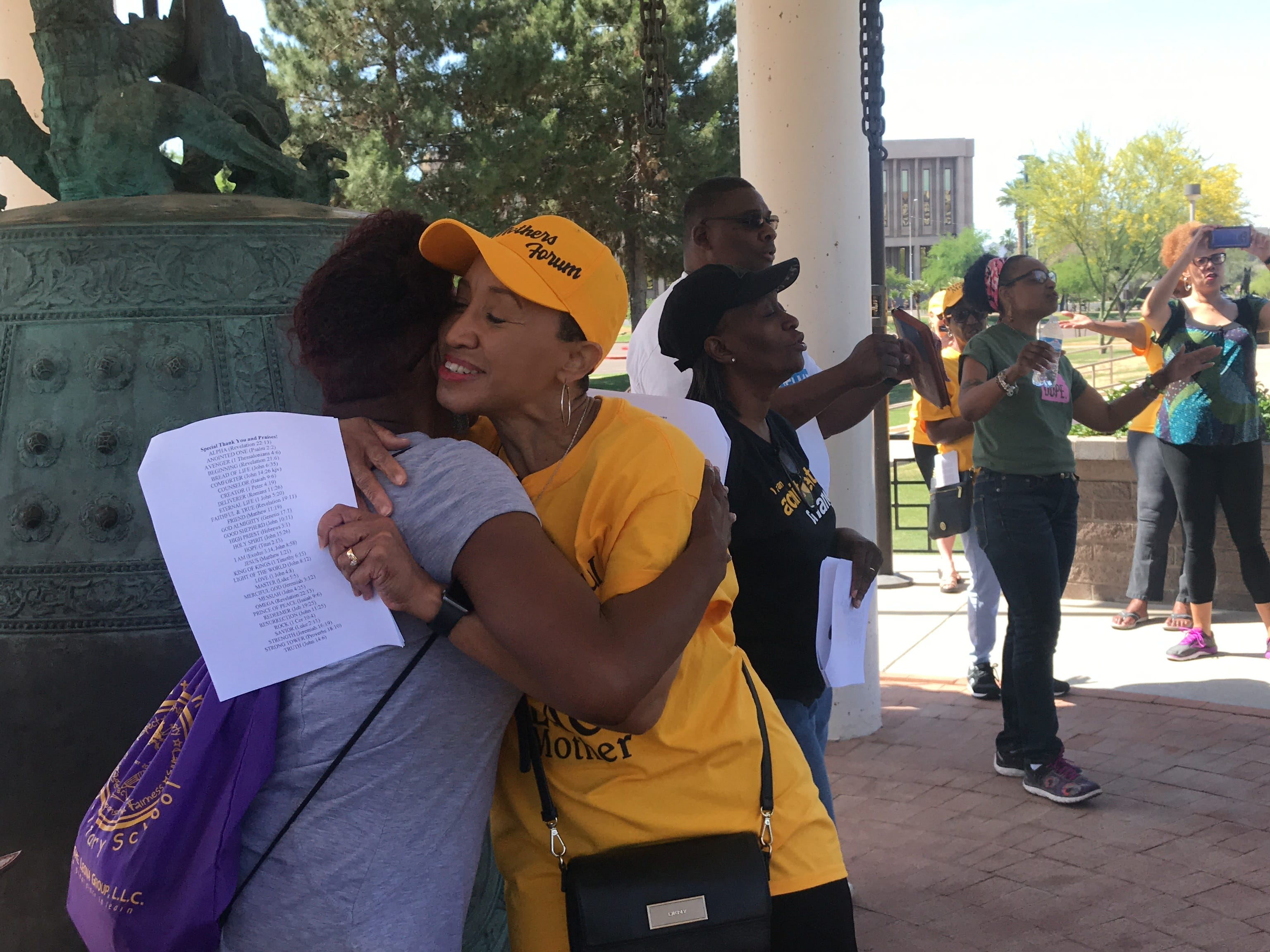 Janelle Wood (right) hugs a member of the Black Mothers Forum during a prayer march on May 11, 2019.