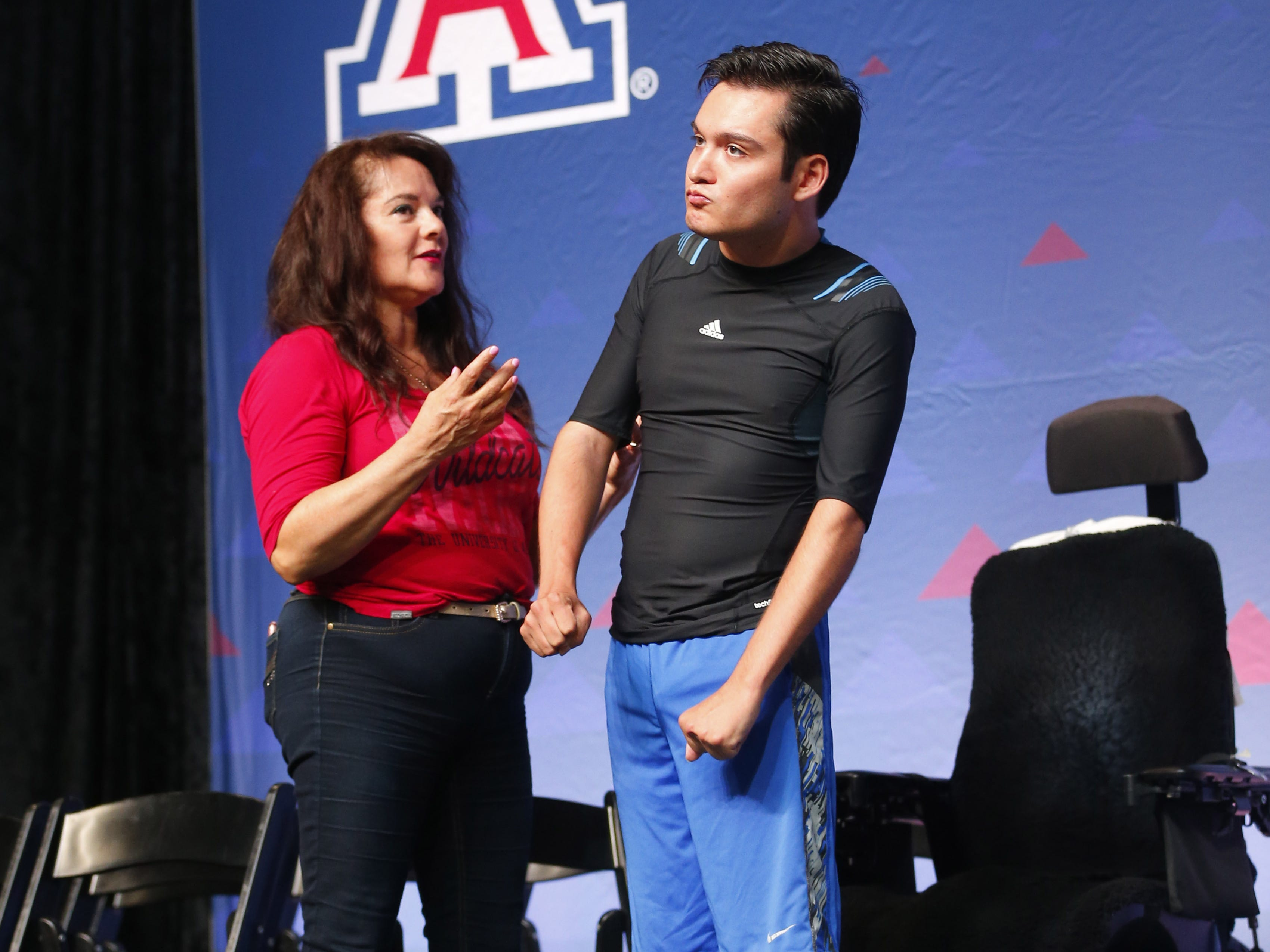University of Arizona graduate Jeffrey Bristol practices walking on stage with his mom, Hermelinda, at McKale Center in Tucson, Ariz. on May 8, 2019.
