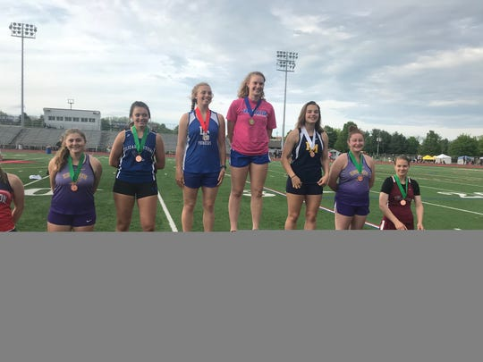 Cedar Crest's Hannah Woelfling reached the top of the medal stand Friday after repeating as Lancaster-Lebanon League discus champion.