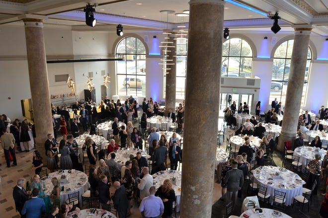 Local business officials mingle on Friday, May 10, 2019, in the CityFlats Hotel ballroom in downtown Port Huron. The Blue Water Area Chamber of Commerce's Eddy Awards was the first event to be held in the venue.