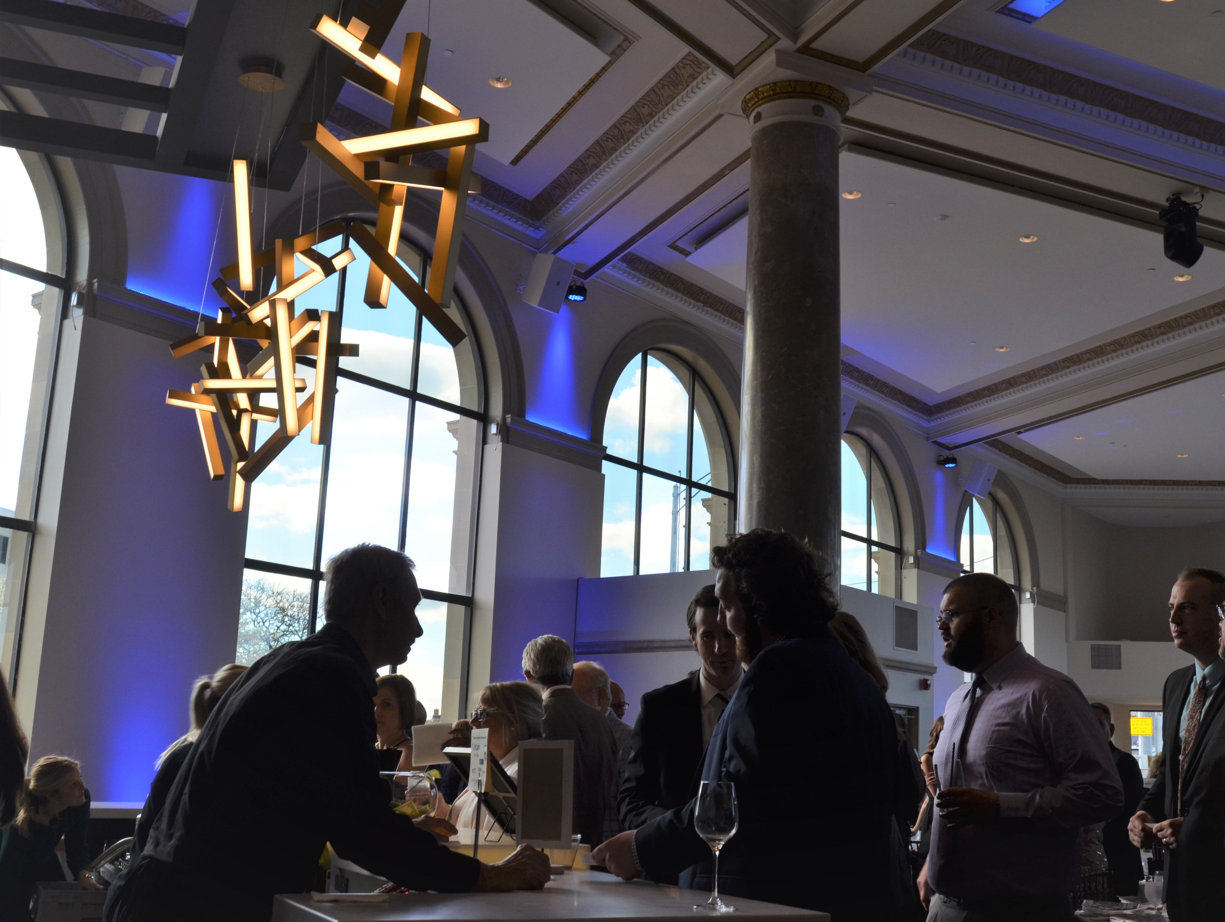 Attendees of the Blue Water Area Chamber of Commerce's Eddy Awards line of for drinks at the bar of the newly-renovated ballroom of the CityFlats Hotel on Friday, May 10, 2019.