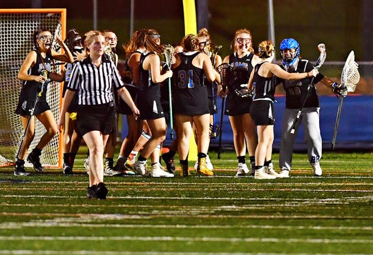 Kennard-Dale celebrates an 11-10 win over York Catholic during girls' lacrosse championship action at Eastern York Senior High School in Wrightsville, Friday, May 10, 2019. Dawn J. Sagert photo