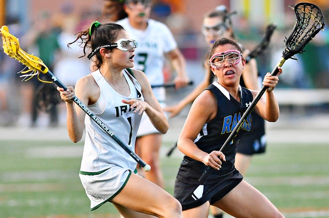 York Catholic's Olivia Staples, left, controls the ball while Kennard-Dale's Jenna Soukaseum defends during York-Adams League girls' lacrosse championship action at Eastern York Senior High School in Wrightsville, Friday, May 10, 2019. Kennard-Dale would win the title game 11-10. Both York Catholic and Kennard-Dale earned District 3 Class 2-A victories on Wednesday night. Dawn J. Sagert photo