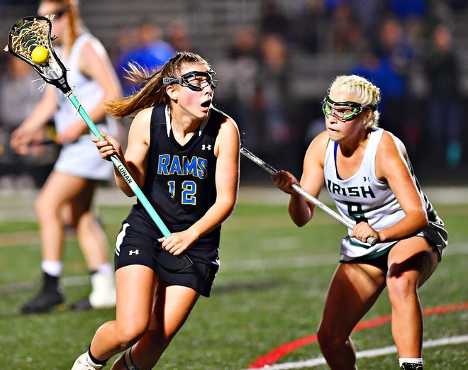 Kennard-Dale's Mackenzie Young, left, controls the ball while York Catholic's Kennedy Eckert defends during girls' lacrosse championship action at Eastern York Senior High School in Wrightsville, Friday, May 10, 2019. Kennard-Dale would win the title game 11-10. Dawn J. Sagert photo