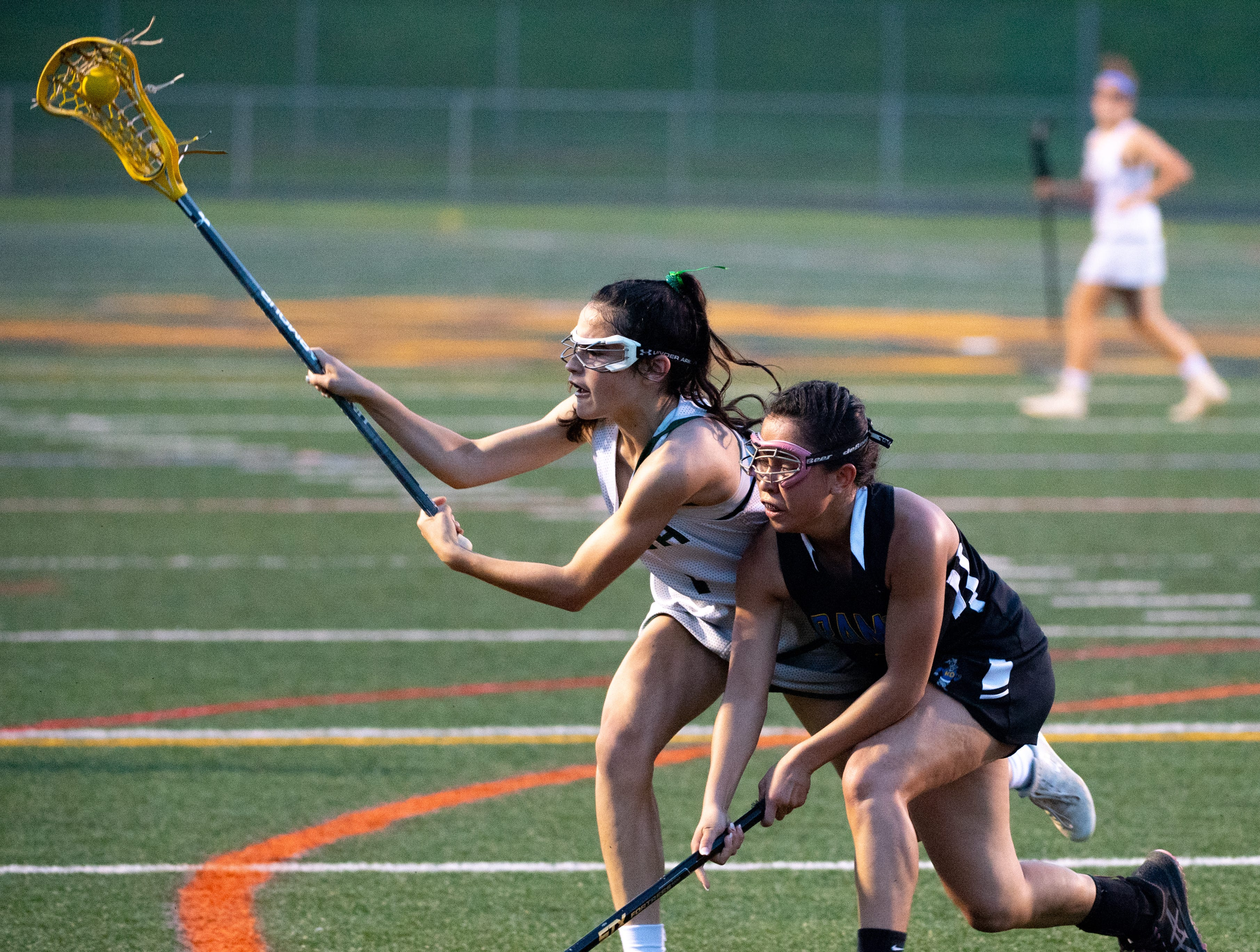 Olivia Staples (1) keeps the ball away from Jenna Soukaseum (1) during the YAIAA girls lacrosse championship game between York Catholic and Kennard-Dale, May 10, 2019 at Eastern York High School. The Rams defeated the Fighting Irish 11 to 10.