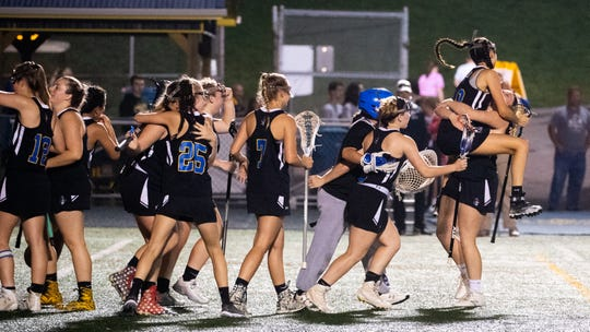 Kennard-Dale celebrates their 11 to 10 win over York Catholic in the YAIAA girls lacrosse championship game, May 10, 2019 at Eastern York High School.