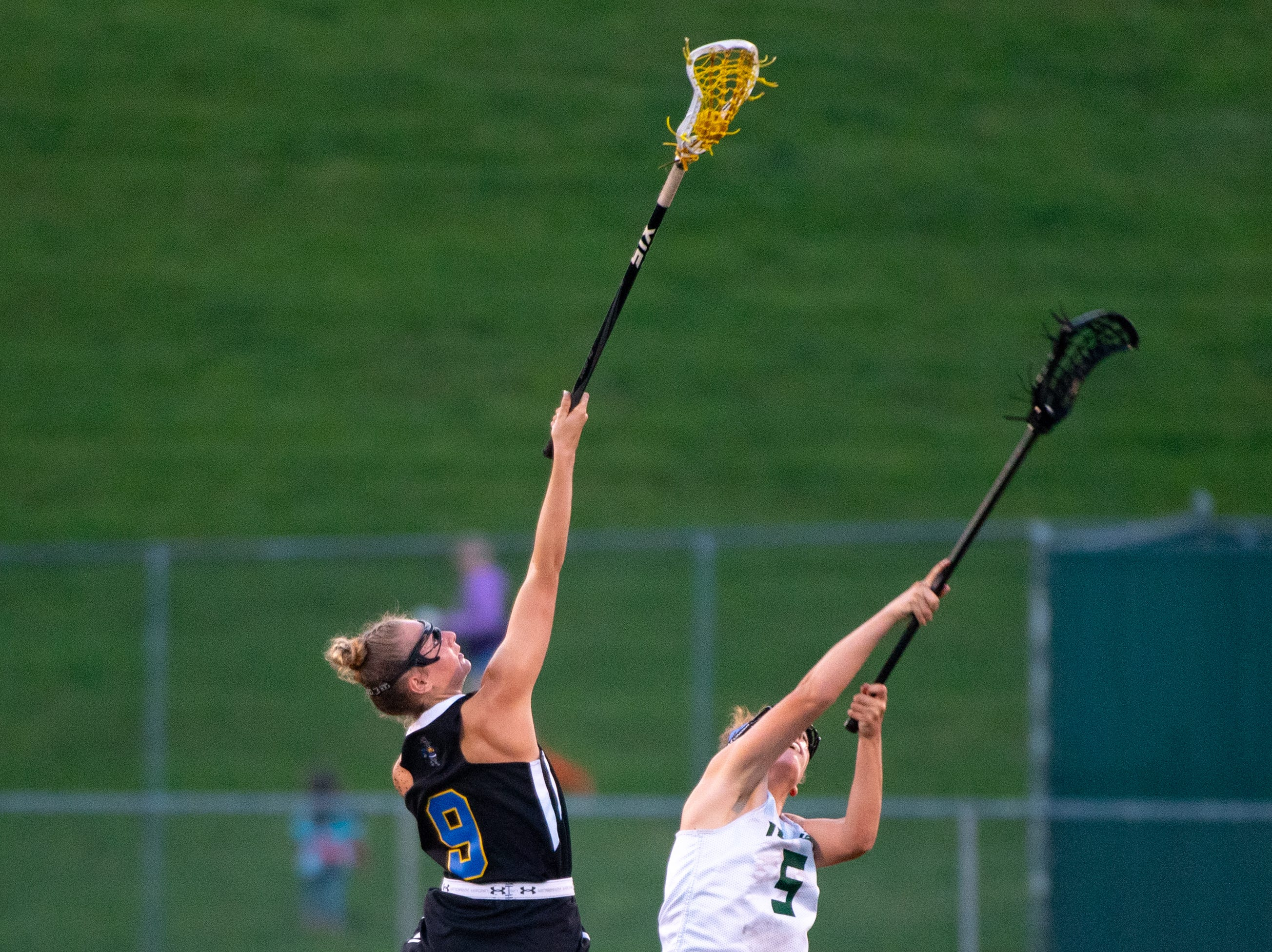 and Grace Doyle (5) face-off during the YAIAA girls lacrosse championship game between York Catholic and Kennard-Dale, May 10, 2019 at Eastern York High School. The Rams defeated the Fighting Irish 11 to 10.