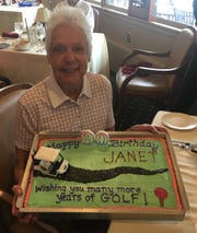 Janet Pope was presented with a cake after Wednesday's round of golf at the Out Door Country Club to celebrate her 90th birthday.