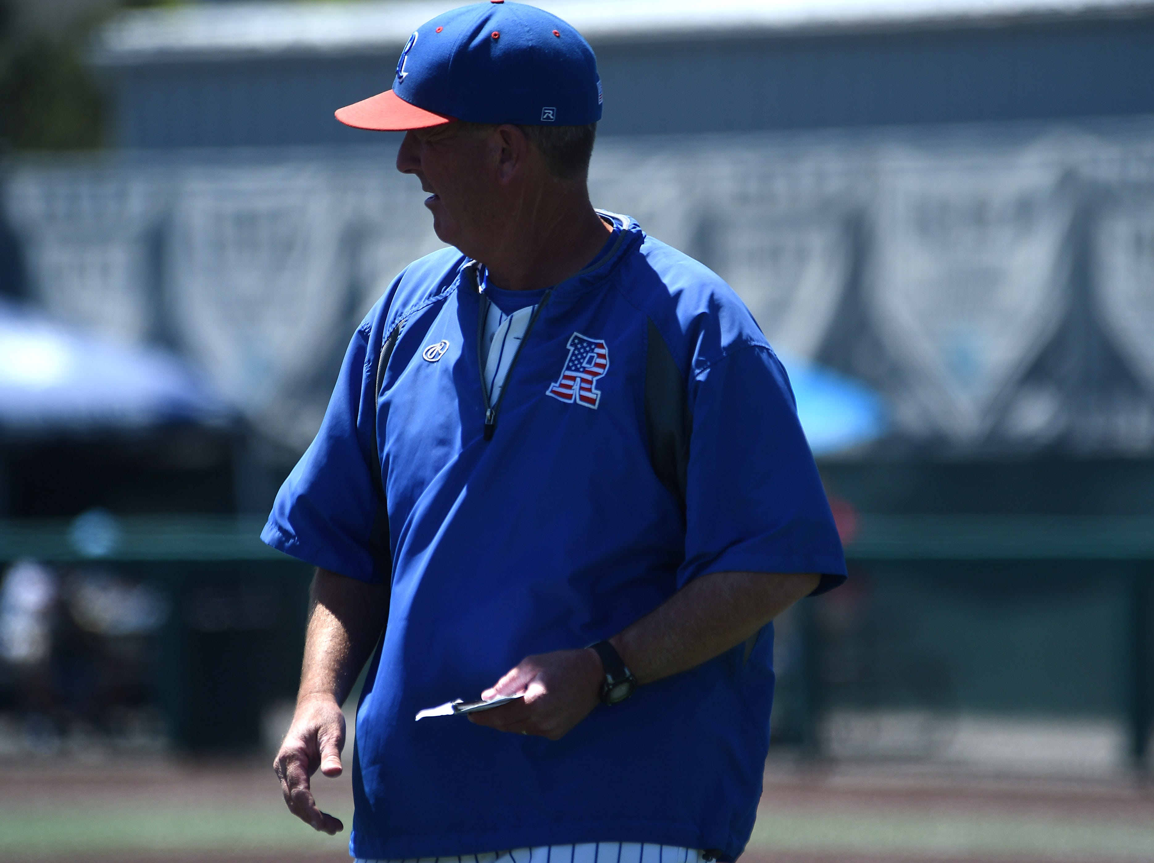 Reno head coach Pete Savage surveys the field while taking on Bishop Manogue during their northern region championship game at Peccole Park in Reno on May 11, 2019.