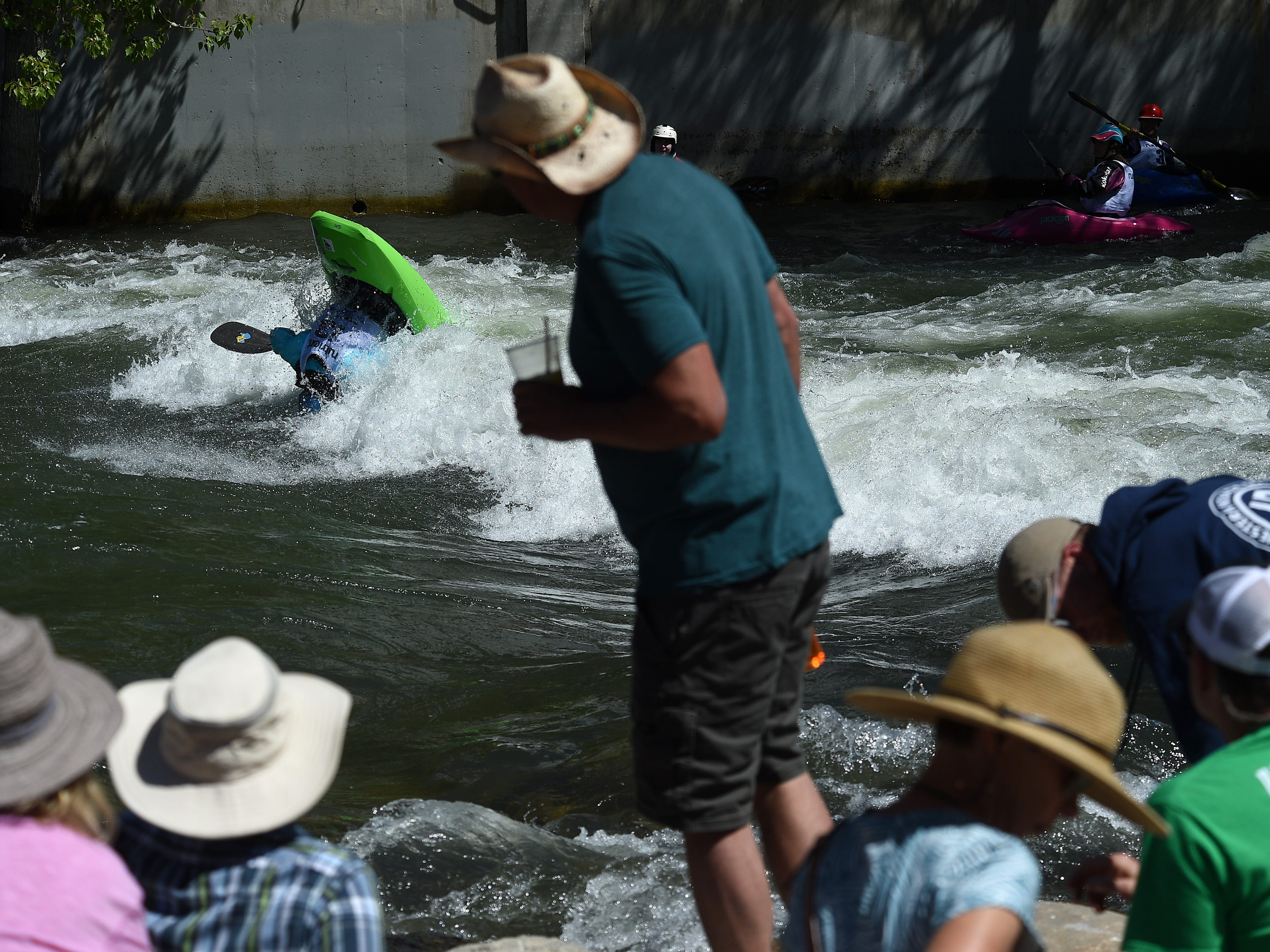 Spectators take in the action during the Reno River Festival on the Truckee River in Wingfield Park on May 11, 2019.