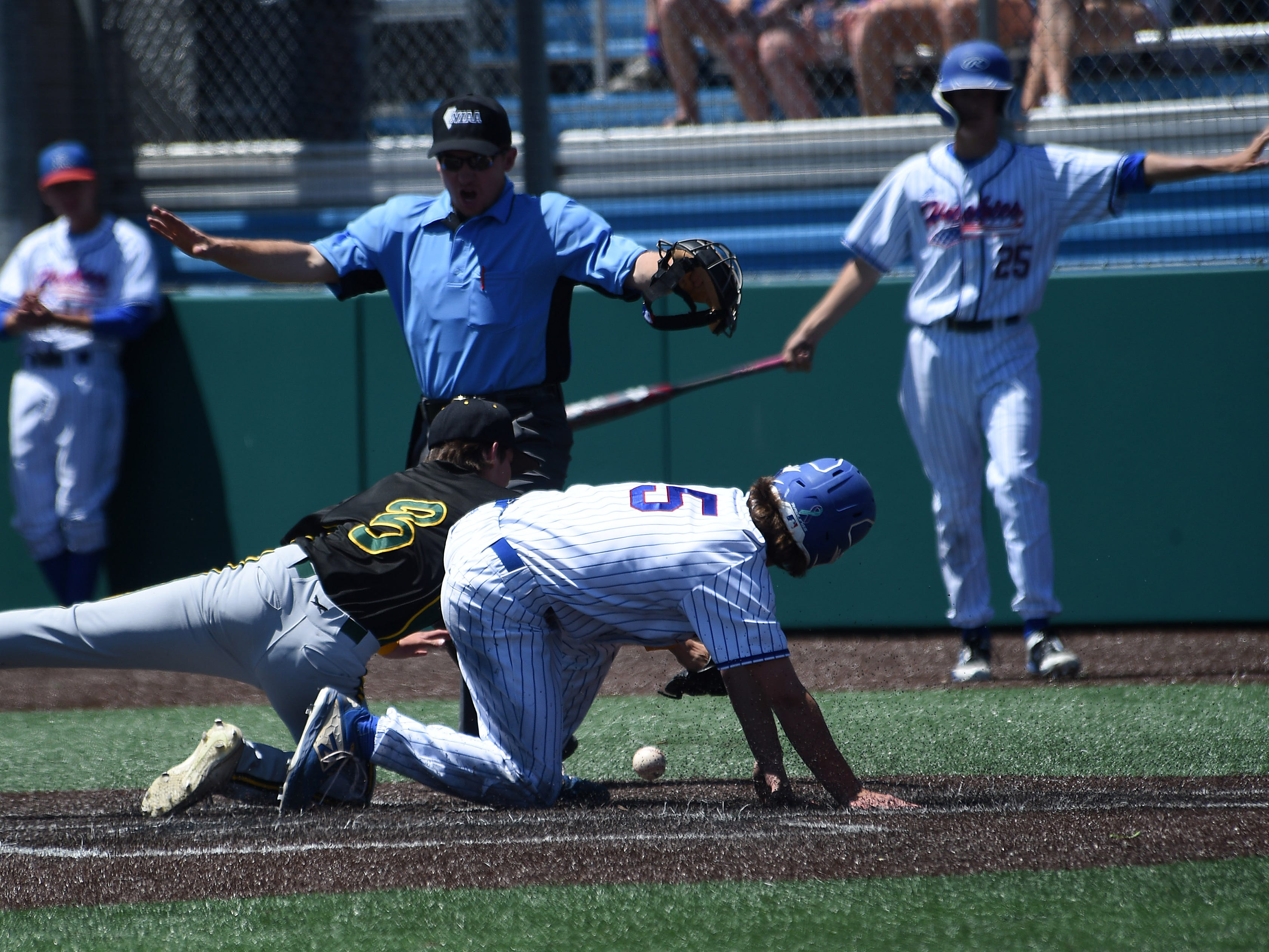 Reno's Drue Worthen (5) is called safe at home while taking on Bishop Manogue during their northern region championship game at Peccole Park in Reno on May 11, 2019.
