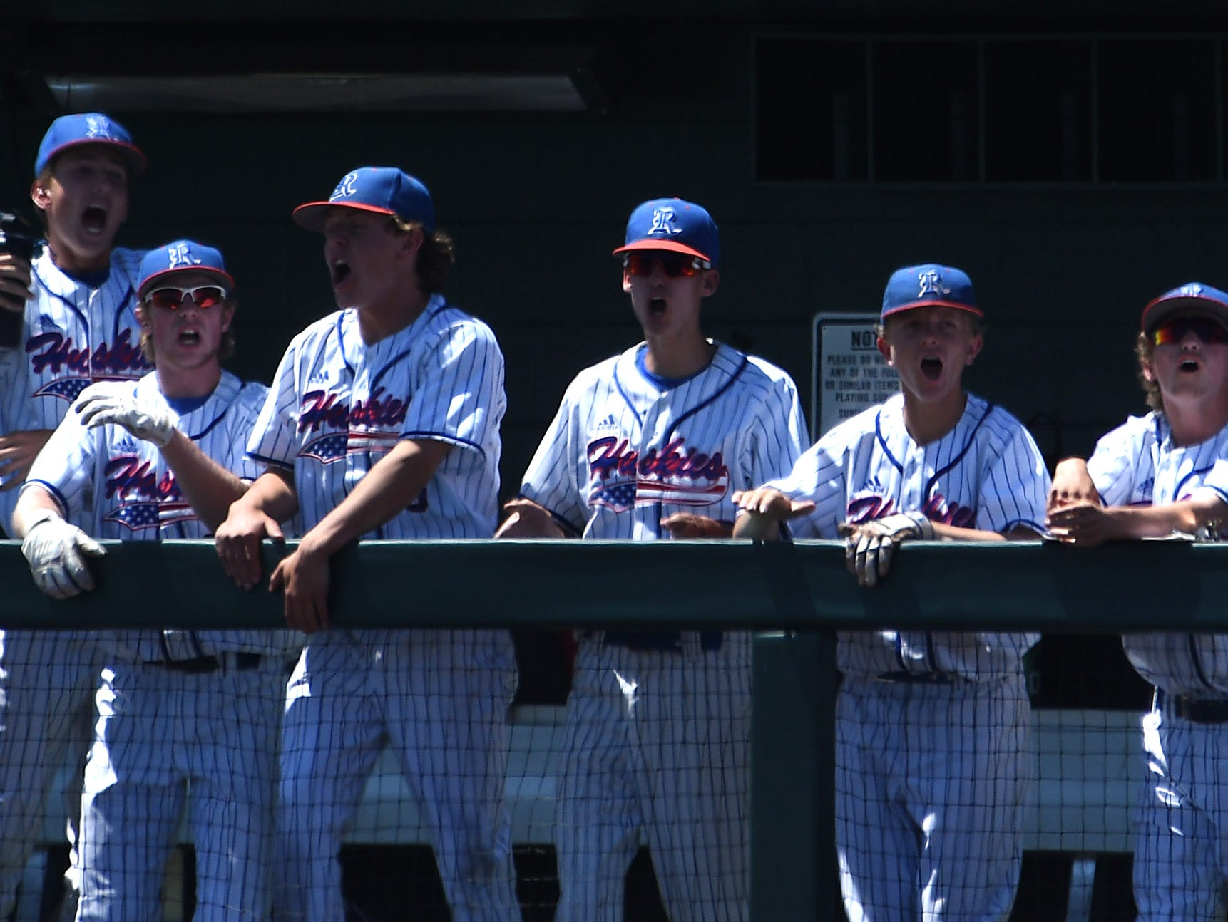 Reno players celebrate while taking on Bishop Manogue during their northern region championship game at Peccole Park in Reno on May 11, 2019.