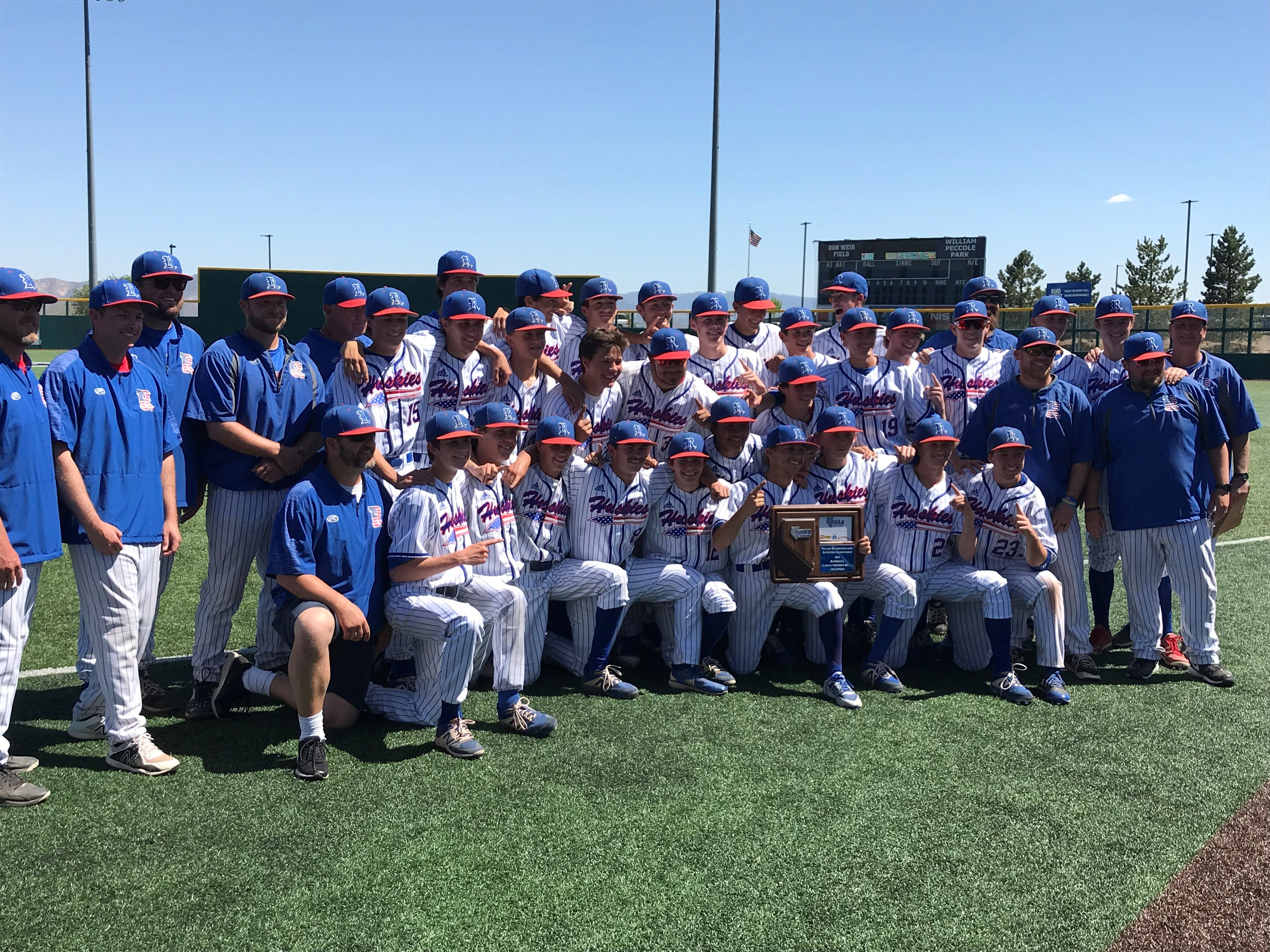 The Reno High baseball team poses with the Northern 4A Regional championship trophy on Saturday at Peccole Park in Reno.