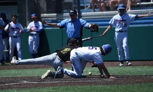 Reno's Drue Worthen (5) is called safe at home while taking on Bishop Manogue during their Northern 4A Region championship game at Peccole Park in Reno on May 11, 2019.