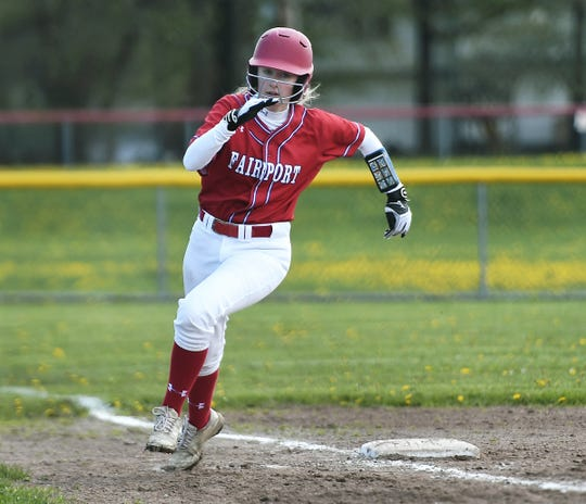 Fairport's Lauren Foster rounds third base on her way to scoring a run against Pittsford Sutherland during a game at Fairport High School, Saturday, May 11, 2019. Fairport beat Pittsford Sutherland 15-0.