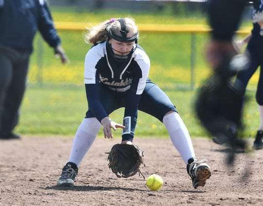 Pittsford Sutherland's Emily Torpey fields a ground ball during a game at Fairport High School, Saturday, May 11, 2019. Fairport beat Pittsford Sutherland 15-0.