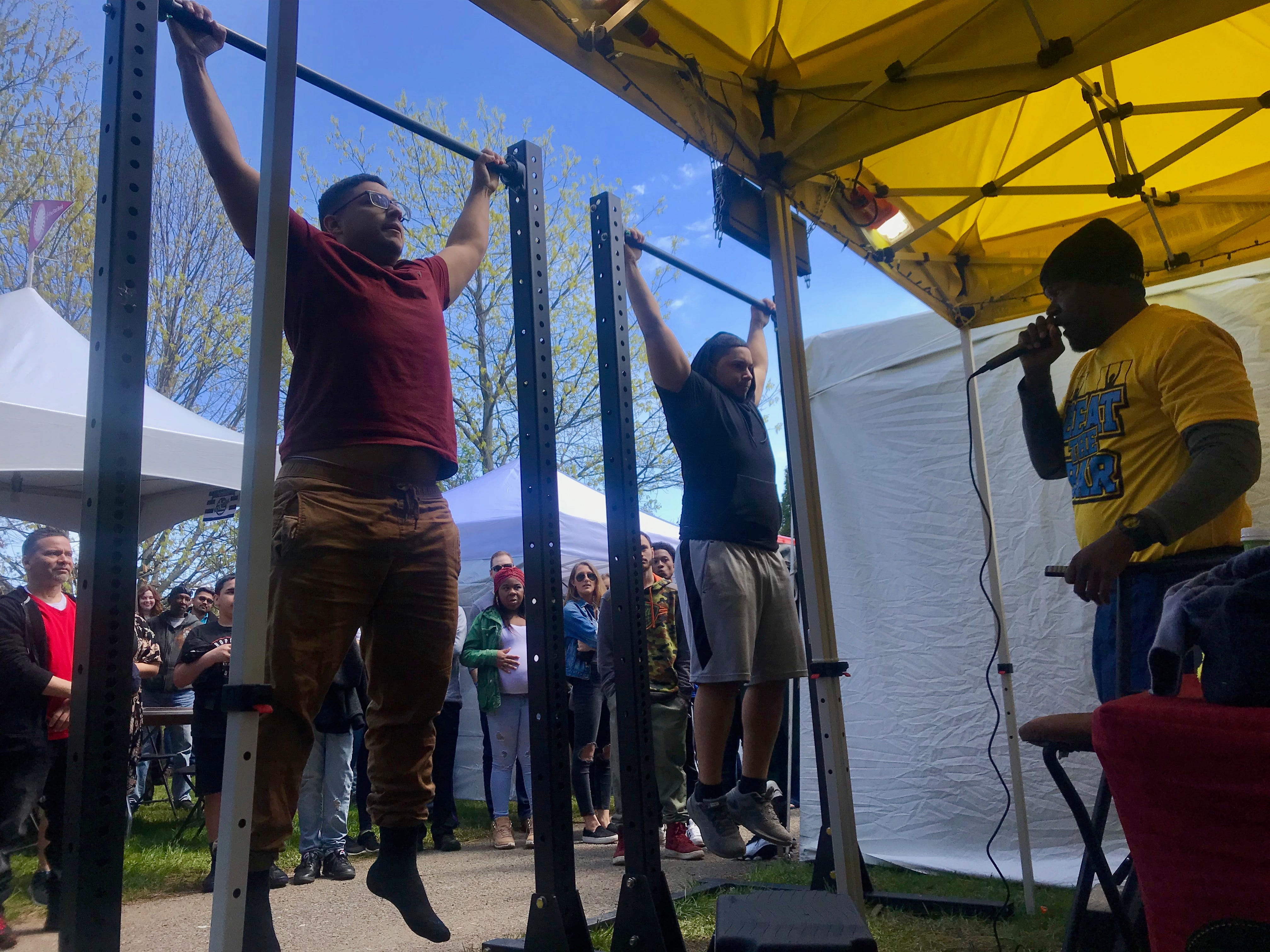 Twin brothers Juan Sampel of Rochester, left, and Jean Sampel of Irondequoit, right, both 22, compete in the Beat the Bar competition at the Rochester Lilac Festival.