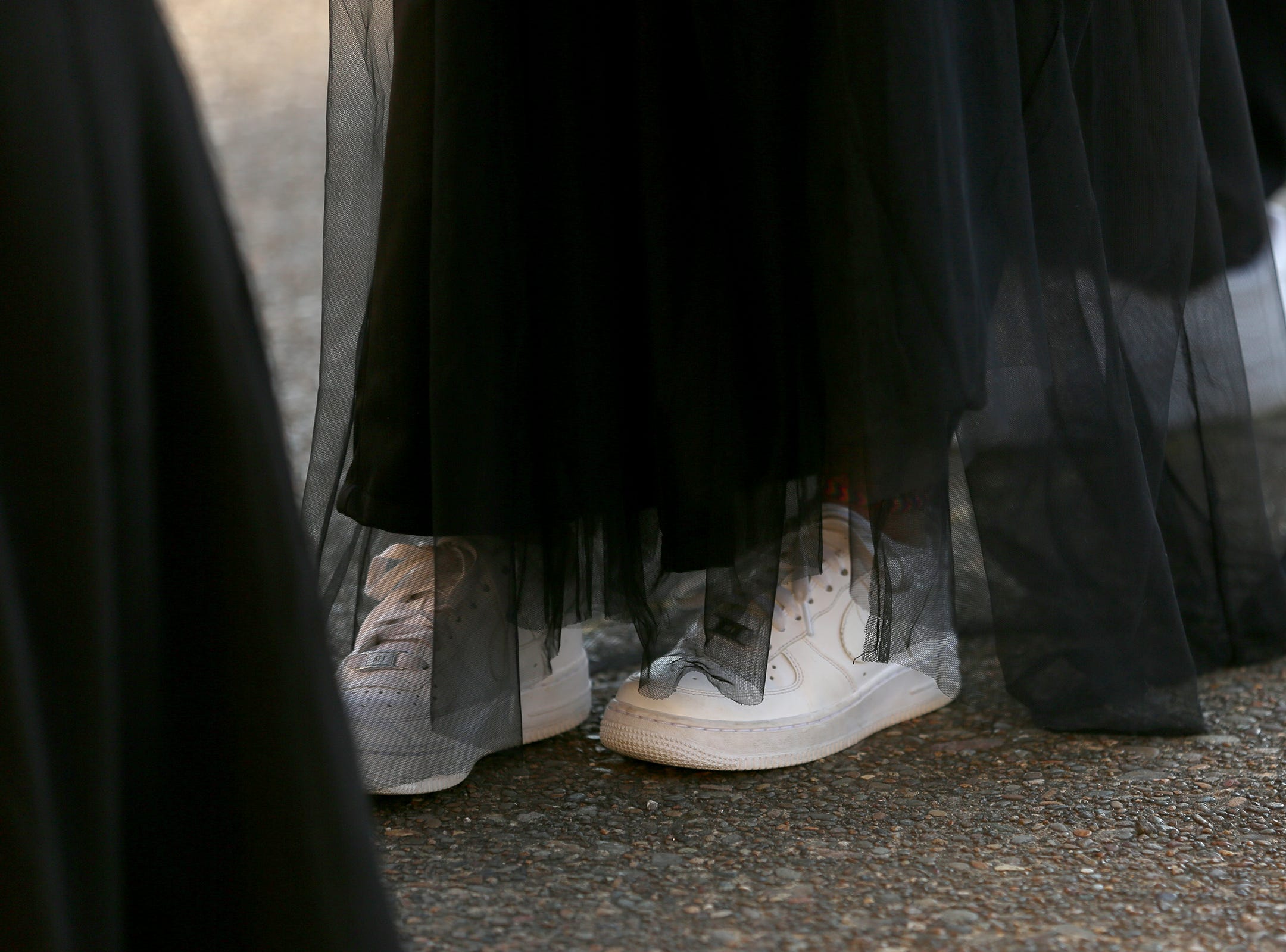 A student wears sneakers under her dress during the Sprague High School prom at Zenith Vineyard in West Salem on May 10, 2019.