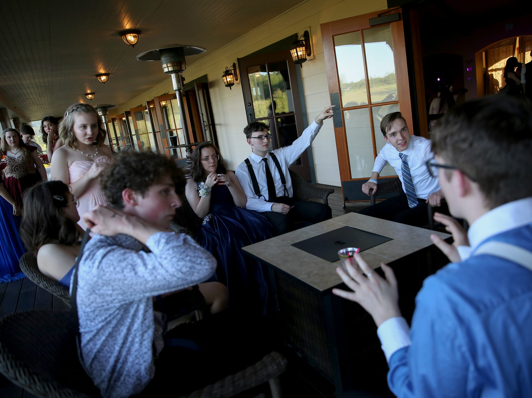 Students hang out outside during the Sprague High School prom at Zenith Vineyard in West Salem on May 10, 2019.