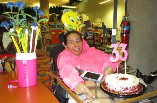 Nana Delgado was honored recently for her loyalty as a patron of the Tom Green County Library. She first came to the library more than 15 years ago as a student worker from Lake View High School.