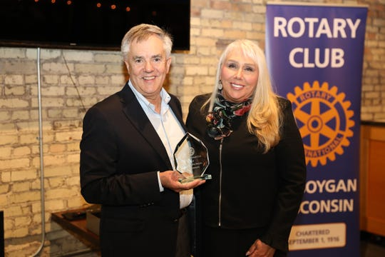Allyson Olivier presents the Sheboygan Rotary Club's Good Citizen of the Year Award to Acuity's Ben Salzmann.