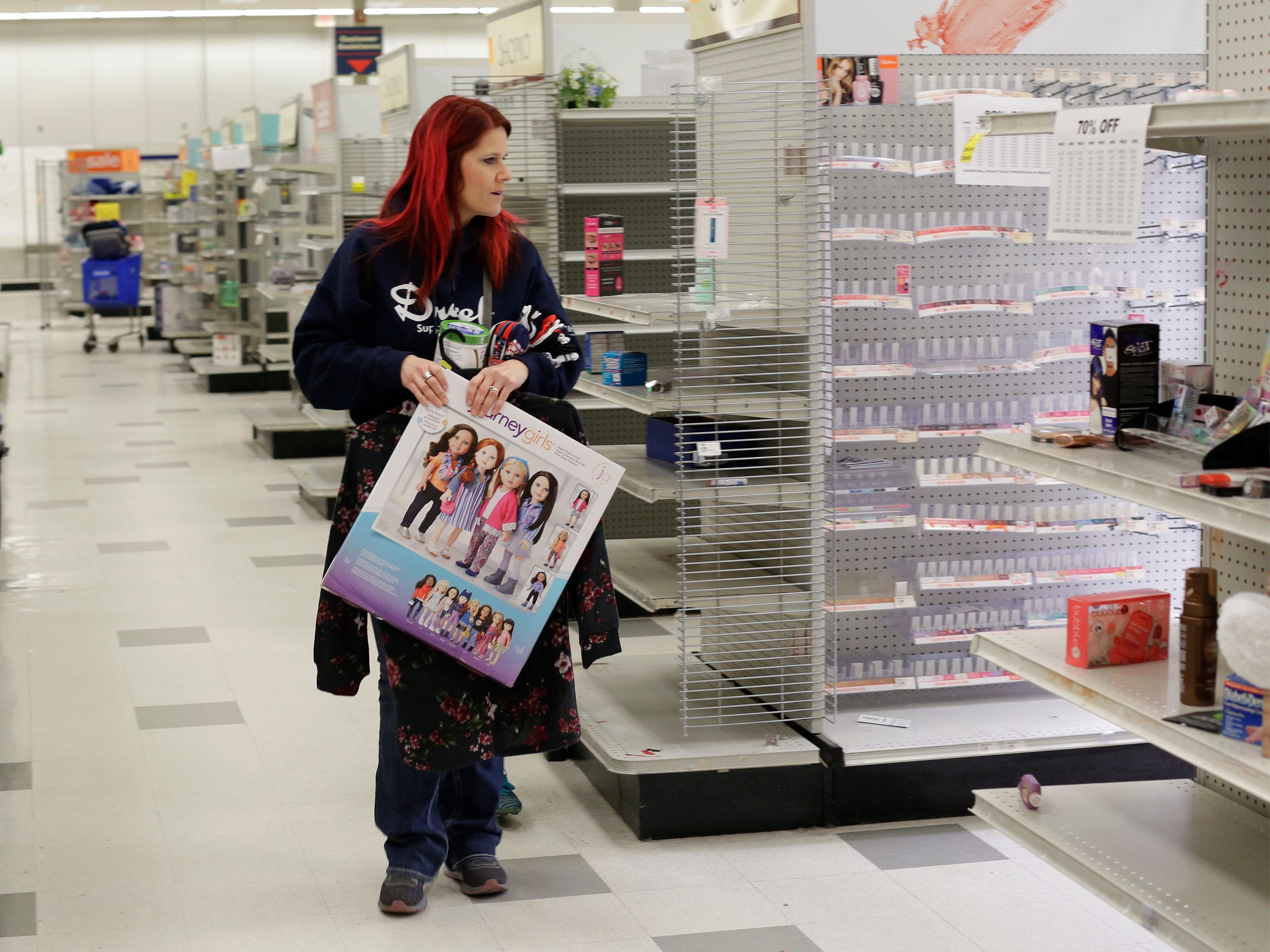 A shopper looks about at ShopKo, Saturday, May 11, 2019, in Sheboygan, Wis.  The Sheboygan location closes this weekend.