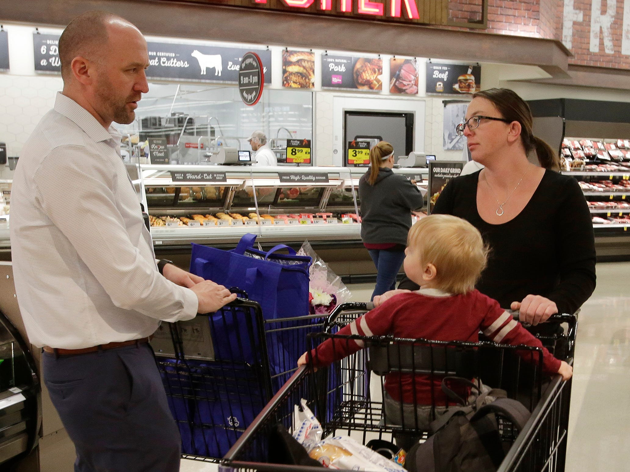 Tasha Peterson of Howards Grove, Wis., right, along with her son Lucas, 2, are presented gifts by Meijer Store Director Jeff  Kietzman at Meijer, Saturday, May 11, 2019, in Sheboygan, Wis.