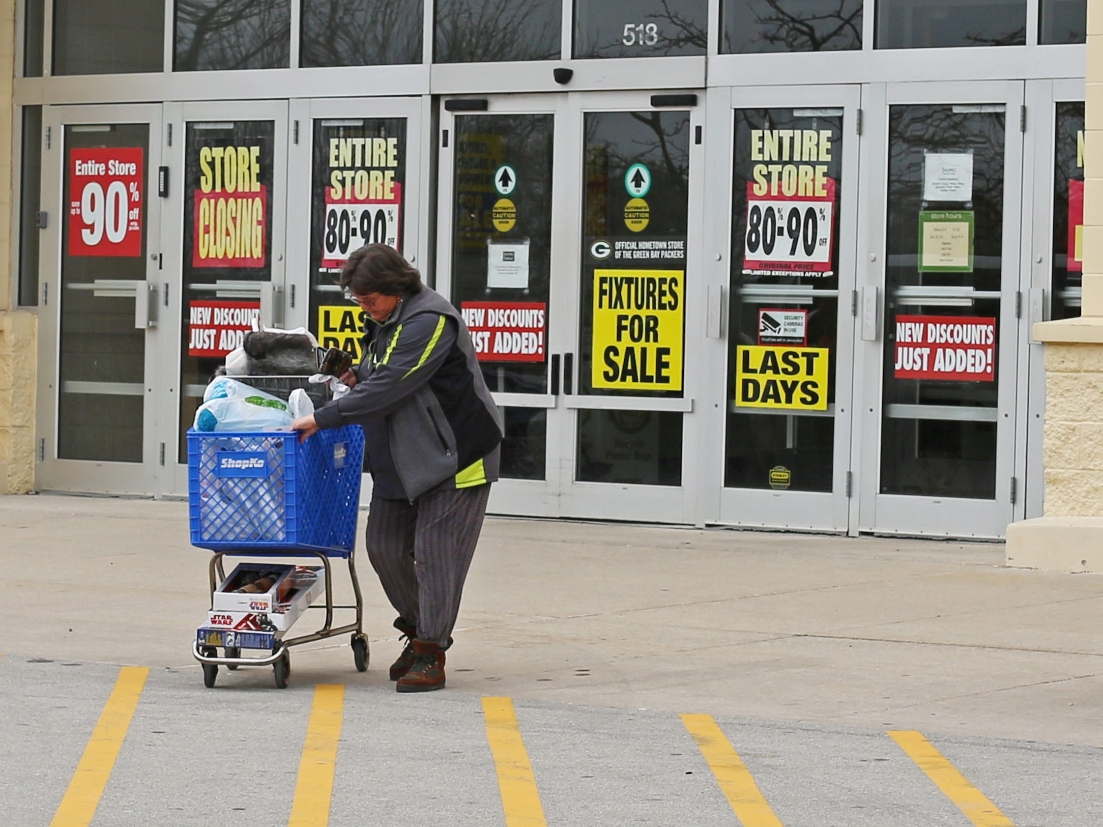 """Susan Weiss of Sheboygan pushes her cart of merchandise after shopping during the store closing sale at ShopKo, Saturday, May 11, 2019, in Sheboygan, Wis. Weiss said, """"I really liked ShopKo and over the years I got some really good deals.  I am going to miss  it.  It was really fun today. I saved $497 saved and paid $131."""""""
