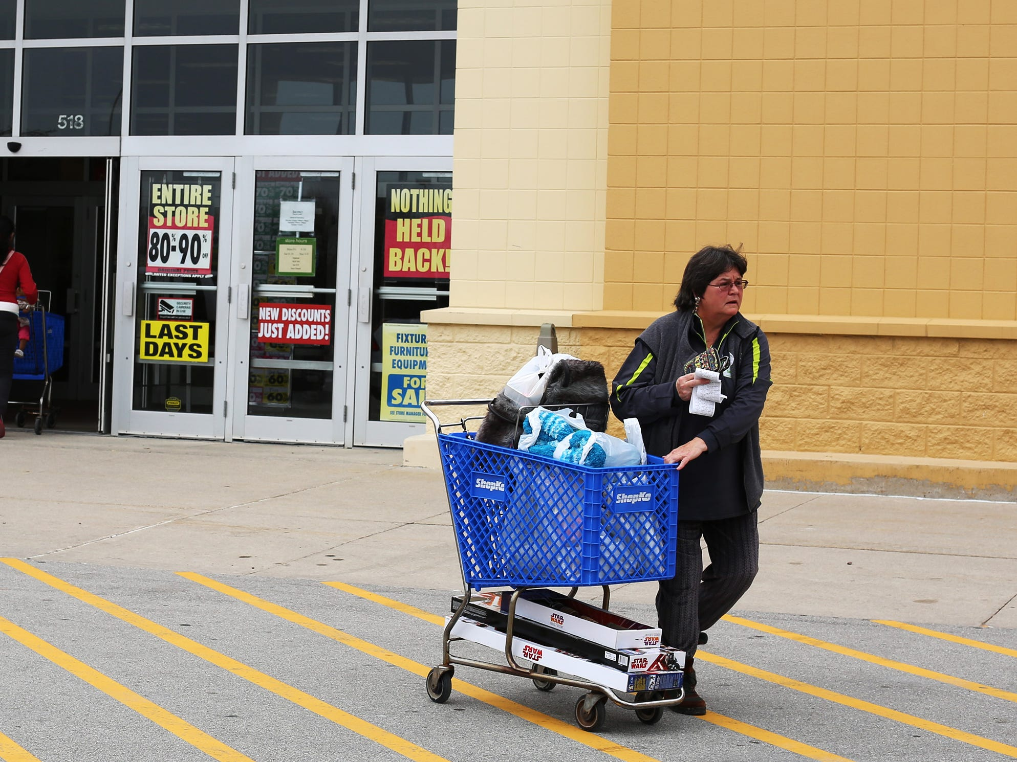 """Susan Weiss of Sheboygan leaves ShopKo, Saturday, May 11, 2019, in Sheboygan, Wis. Weiss said, """"I really liked ShopKo and over the years I got some really good deals.  I am going to miss  it.  It was really fun today. I saved $497 saved and paid $131."""""""