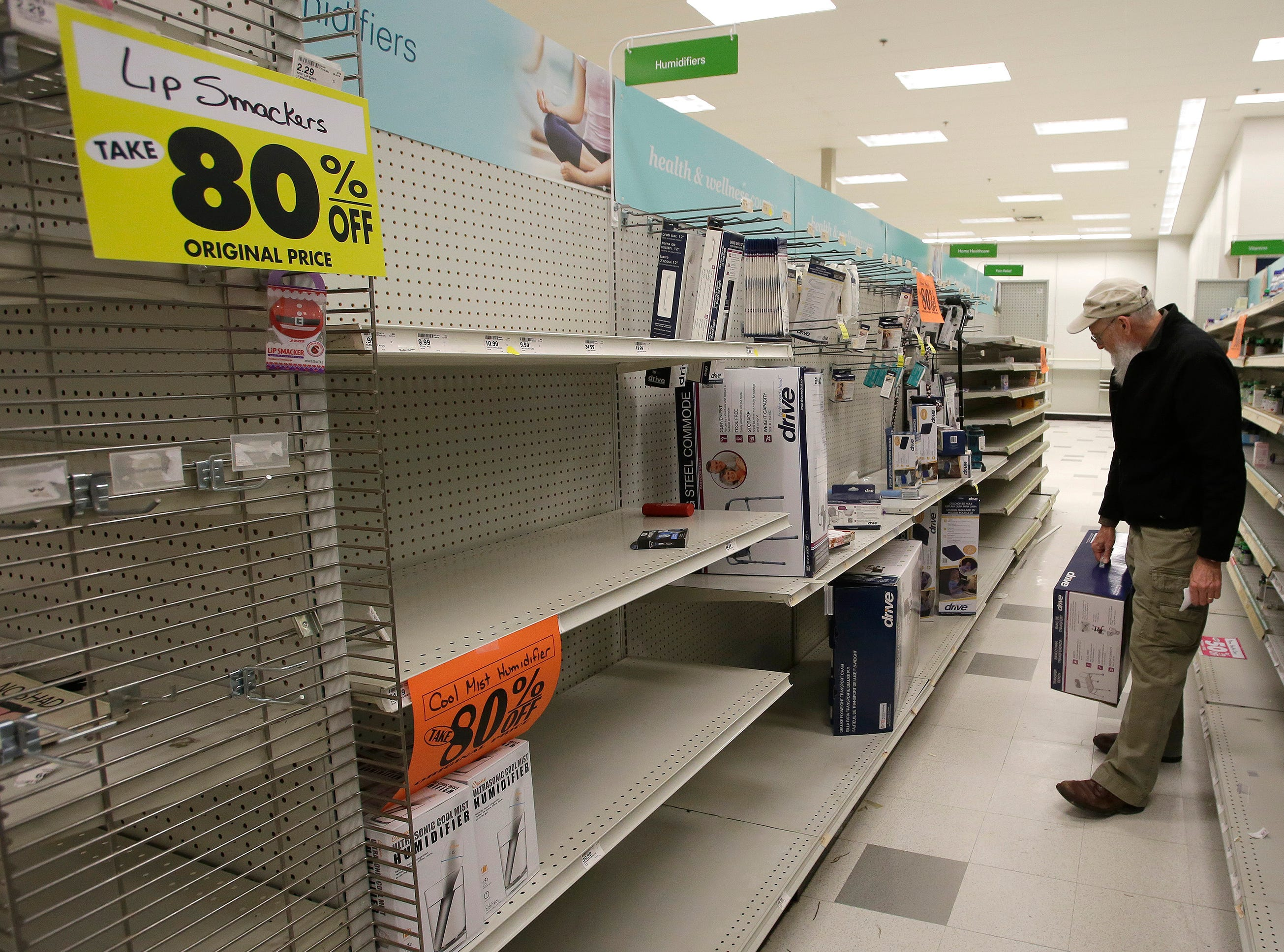 Chuck, who did not want his last name used, looks over nearly barren shelves at ShopKo, Saturday, May 11, 2019, in Sheboygan, Wis. The store is in its last weekend in Sheboygan.
