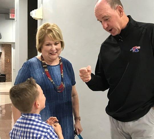 Louisiana Tech coach Skip Holtz prepares to fist-bump Gabe Hochstetler while his grandmother Betty Hochstetler at the Bossier Civic Center.
