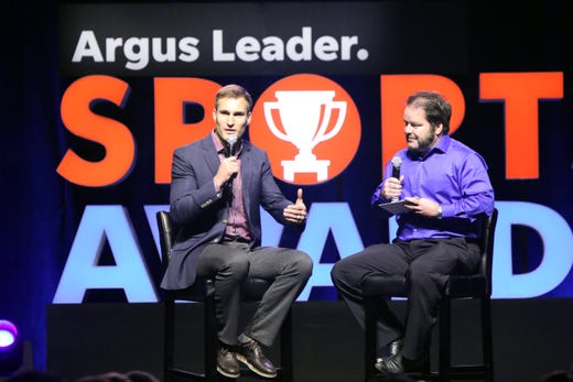 Matt Zimmer of the Argus Leader visits with Kirk Cousins of the Minnesota Vikings at the Argus Leader Sports Awards ceremony Friday night at the Pentagon.