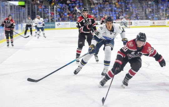 Andre Lee of the Sioux Falls Stampede races to the puck against Chicago Steel players in game one of the Clark Cup finals on Friday, May 10, at the Sanford Premier Center in Sioux Falls.