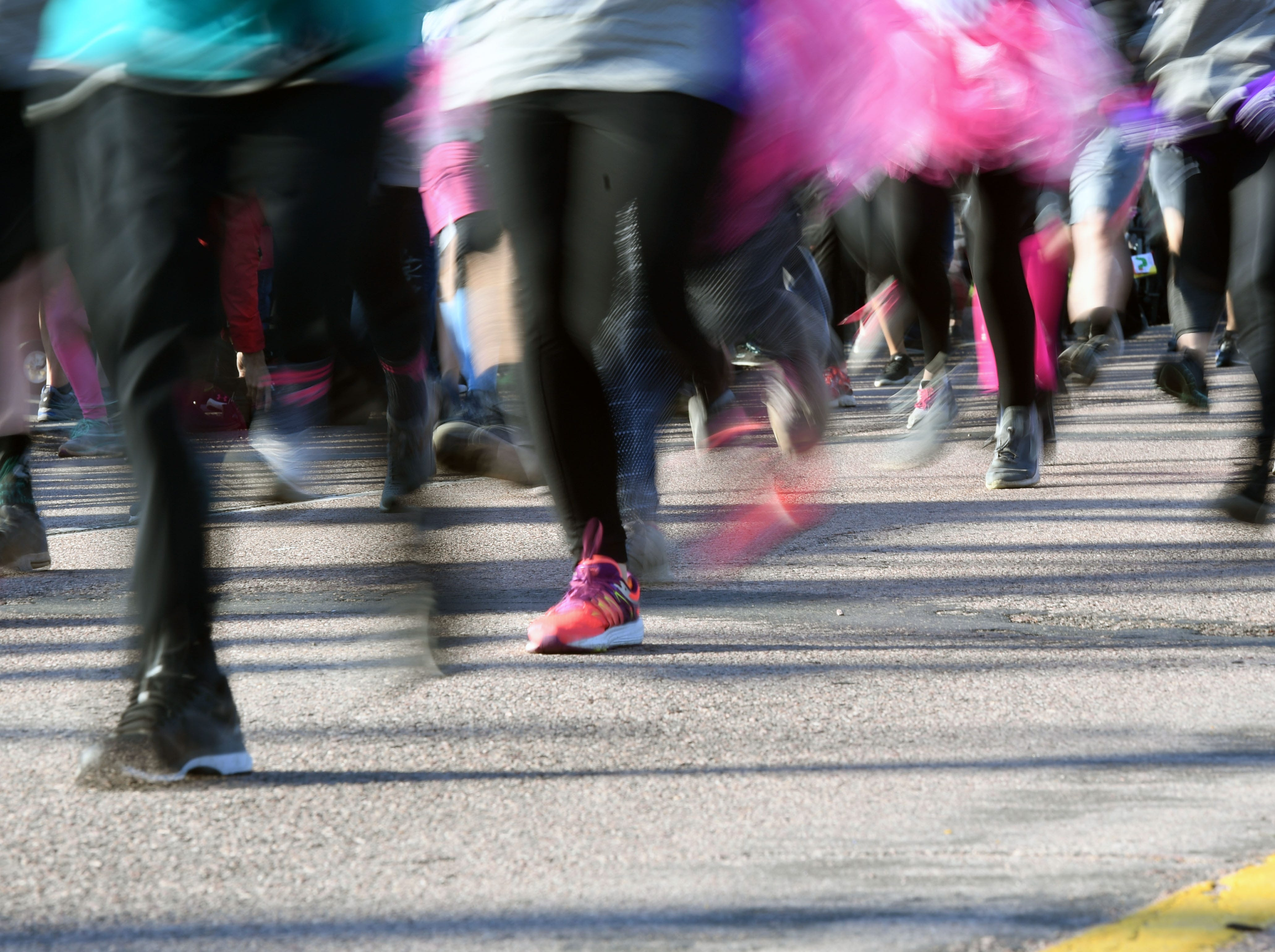 Many runners in the 5K race donned pink running shoes, socks and even tutus for the 31st Avera Health Race Against Cancer on Saturday morning, May 11, in Sioux Falls.