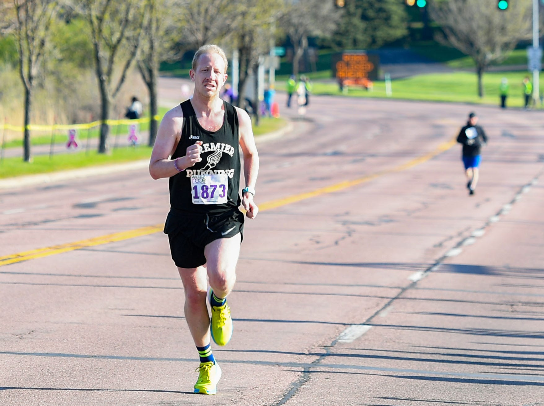 Marshall Kambestad is the first 10K runner to cross the finish line at the 31st Avera Health Race Against Cancer on Saturday morning, May 11, in Sioux Falls.