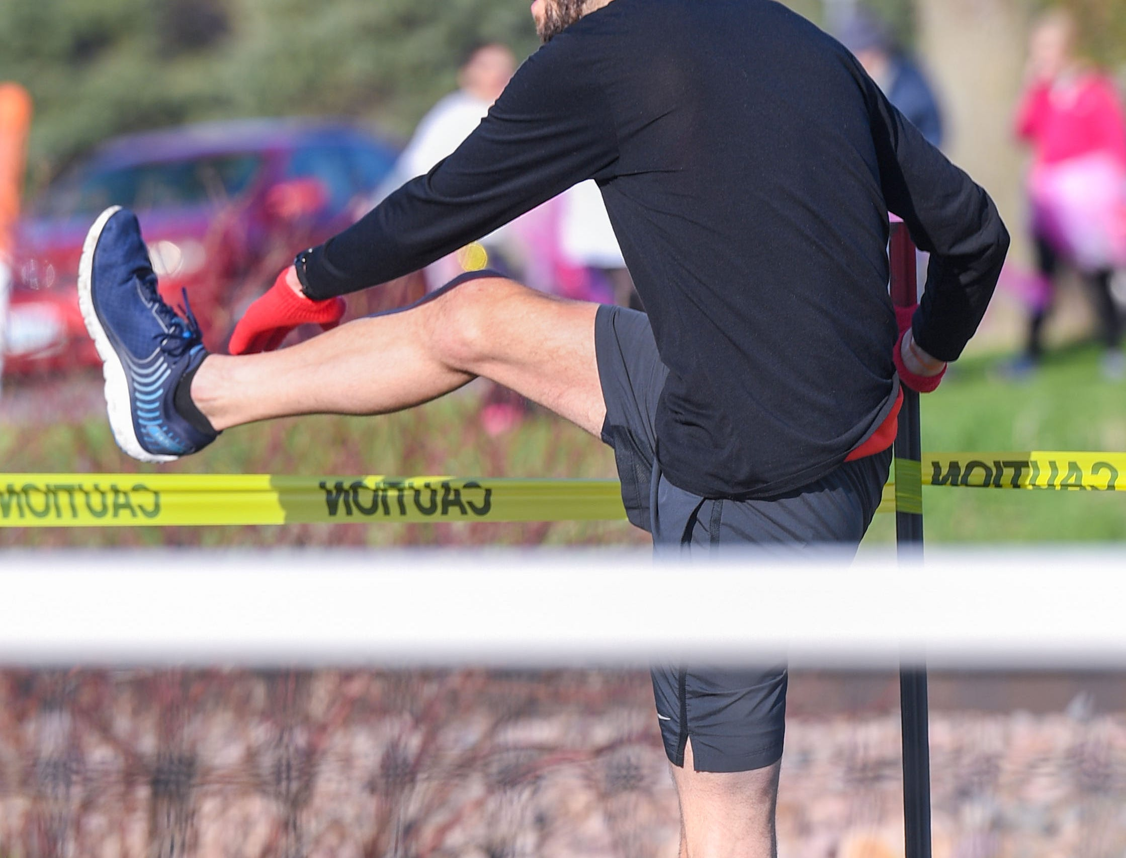 A runner stretches in the last few minutes before the 10K race at the 31st Avera Health Race Against Cancer on Saturday morning, May 11, in Sioux Falls.