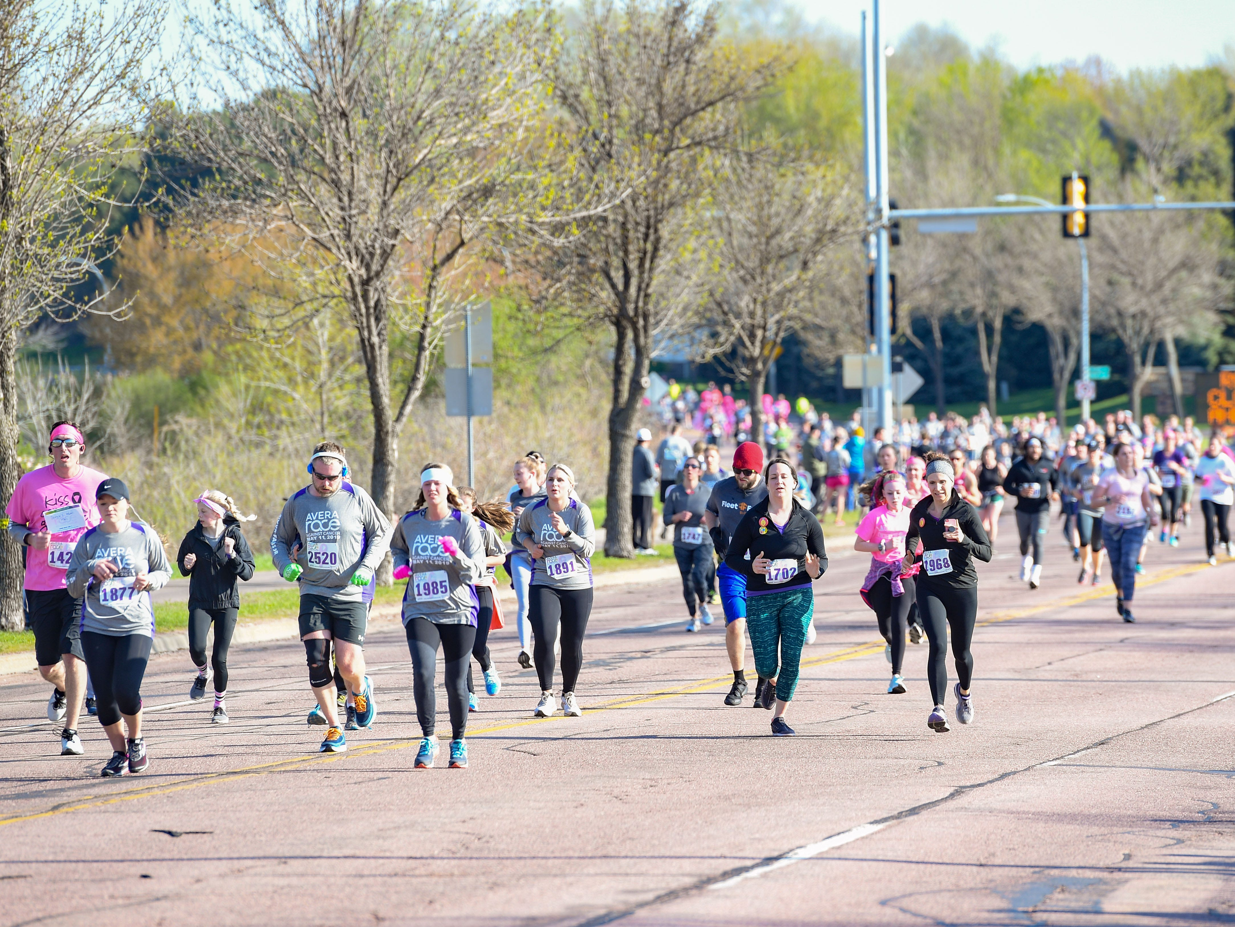 Runners make their way back to the finish line at the 31st Avera Health Race Against Cancer on Saturday morning, May 11, in Sioux Falls.