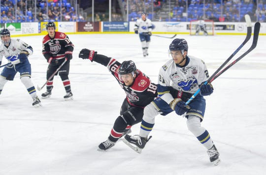 Austen Swankler of the Sioux Falls Stampede chases the puck against John Spetz of the Chicago Steel in the Clark Cup finals on Friday, May 10, at the Sanford Premier Center in Sioux Falls.