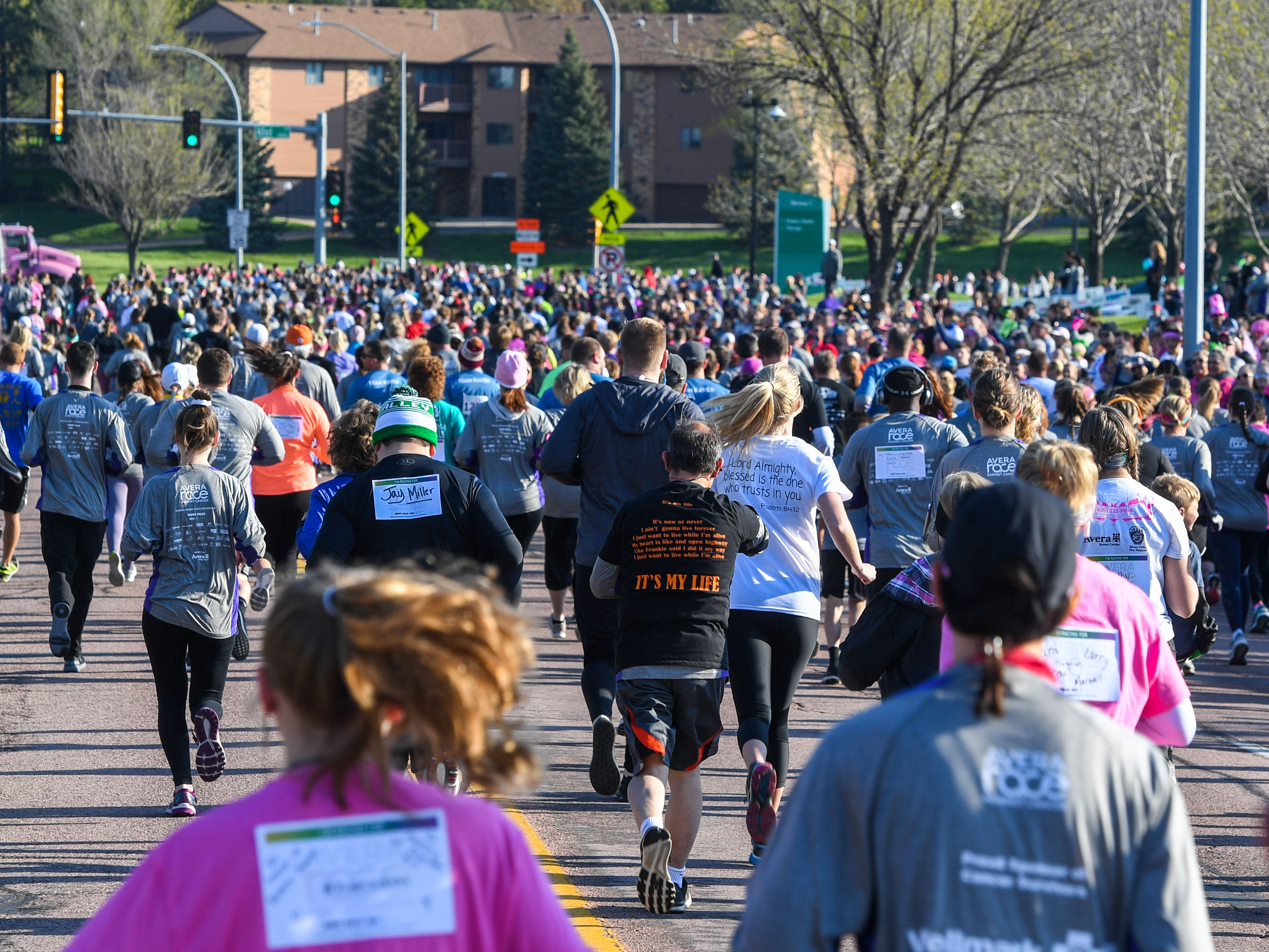 5K runners head north from the event site for the 31st Avera Health Race Against Cancer on Saturday morning, May 11, in Sioux Falls.