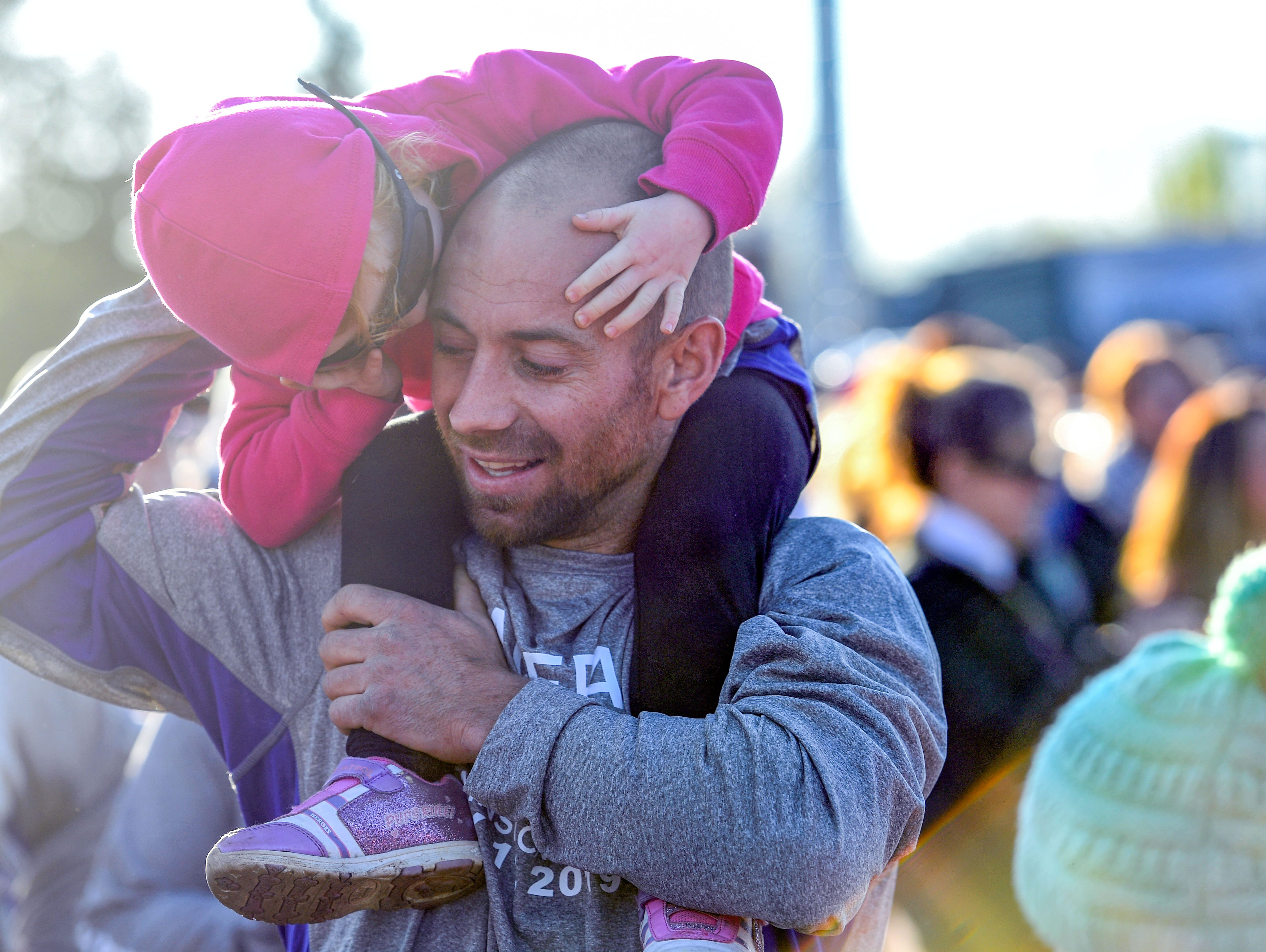Matt Glanzer shares a moment with his daughter, Matea, 3, before running in the 31st Avera Health Race Against Cancer on Saturday morning, May 11, in Sioux Falls.