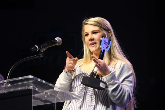 Lauryn Driscoll of West Central accepts the Girls Golfer Award at the Argus Leader Sports Awards ceremony Friday night at the Pentagon.