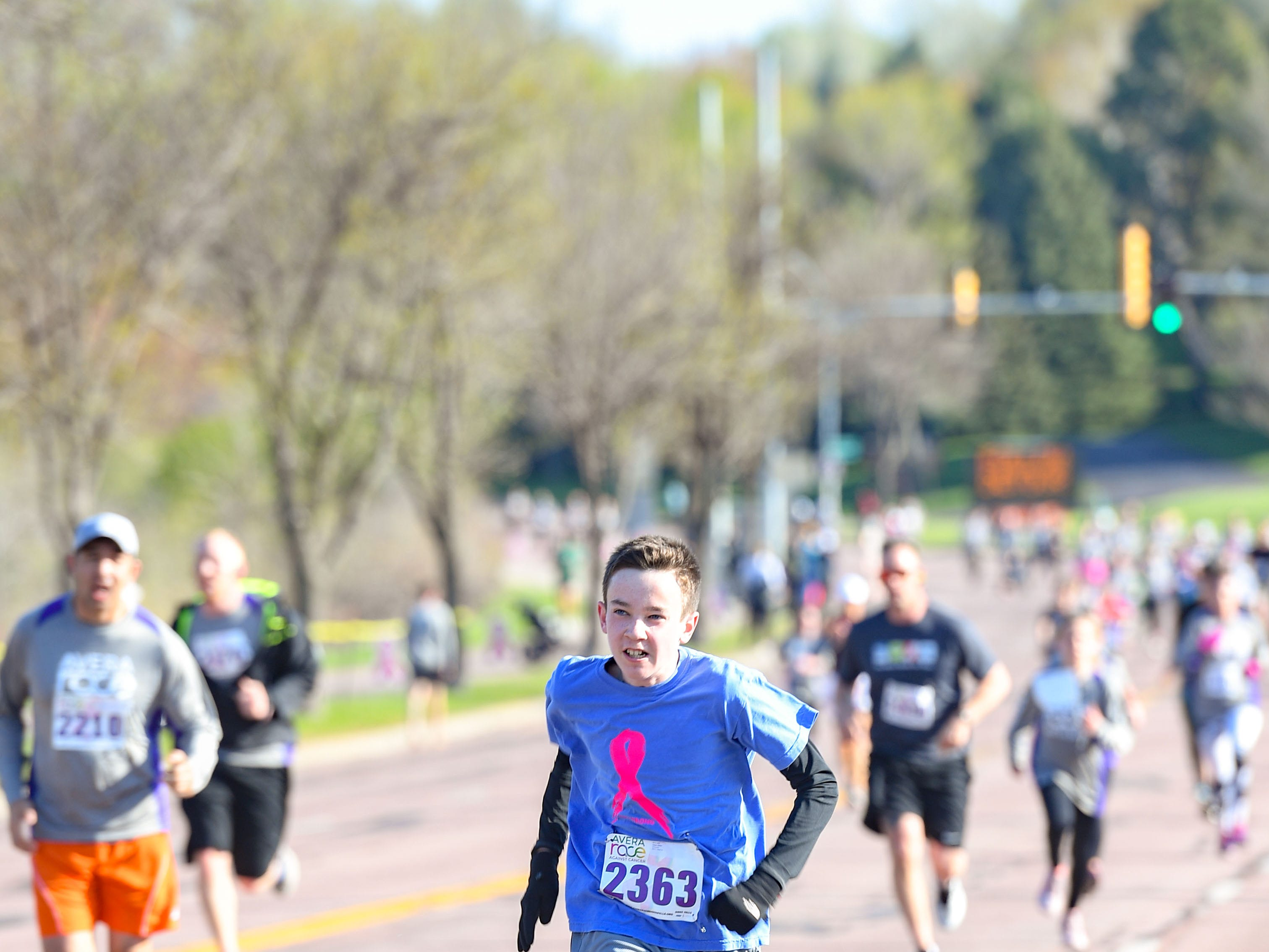 A young runner heads to the finish line at the 31st Avera Health Race Against Cancer on Saturday morning, May 11, in Sioux Falls.