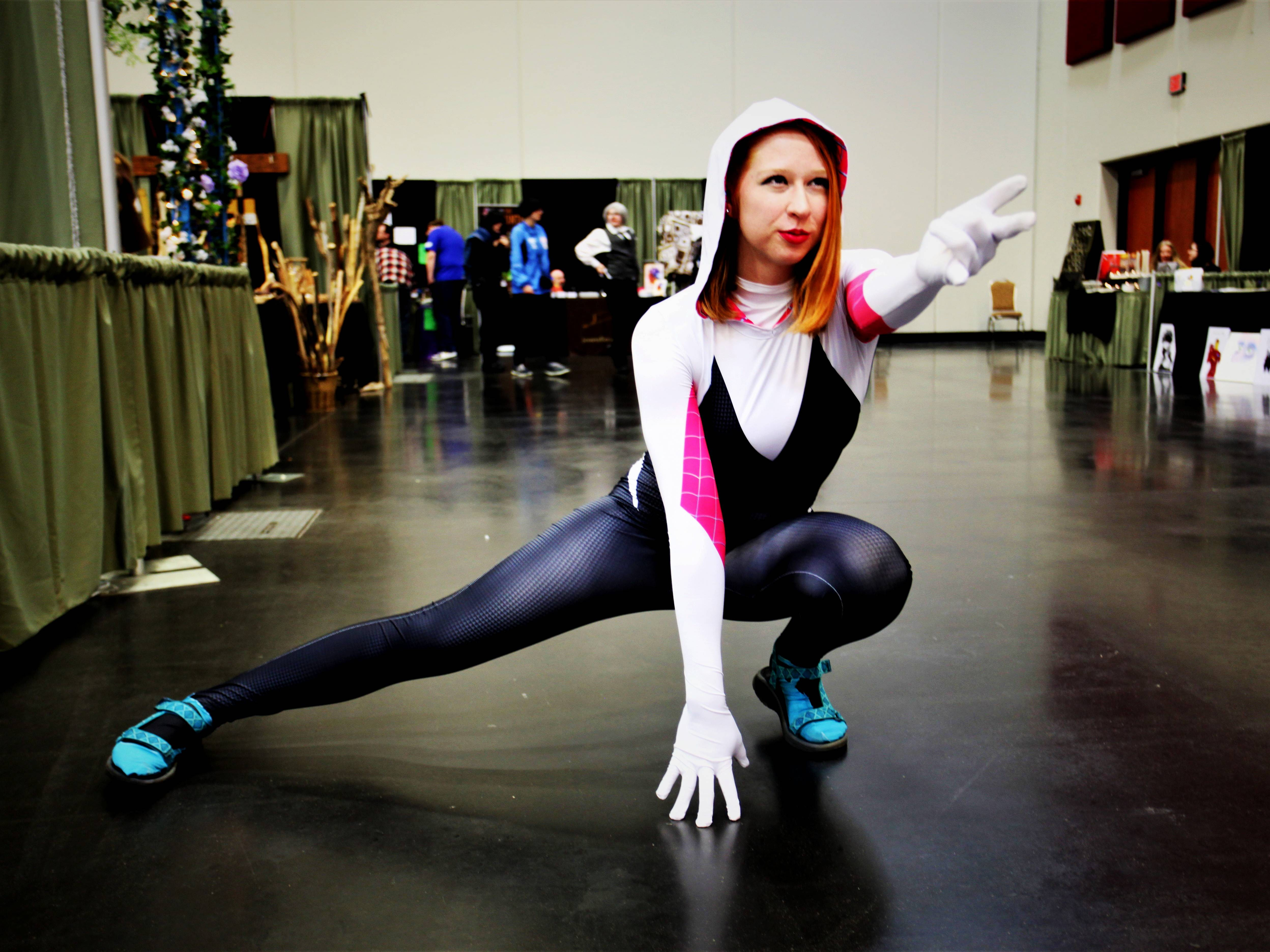 """Tesia White, of Gainesville, strikes a pose as Spider MJ, a mashup of Spider-Gwen and MJ from """"Spider-Man: Into the Spider-Verse"""" at Visioncon on Saturday, May 11, 2019."""