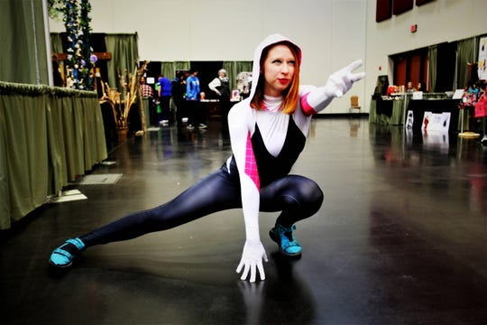 """Tesia White, of Gaiensville, strikes a pose as Spider-MJ, a mashup of Mary Jane and Spider-Gwen from """"Spider-Man: Into the Spider-Verse."""""""