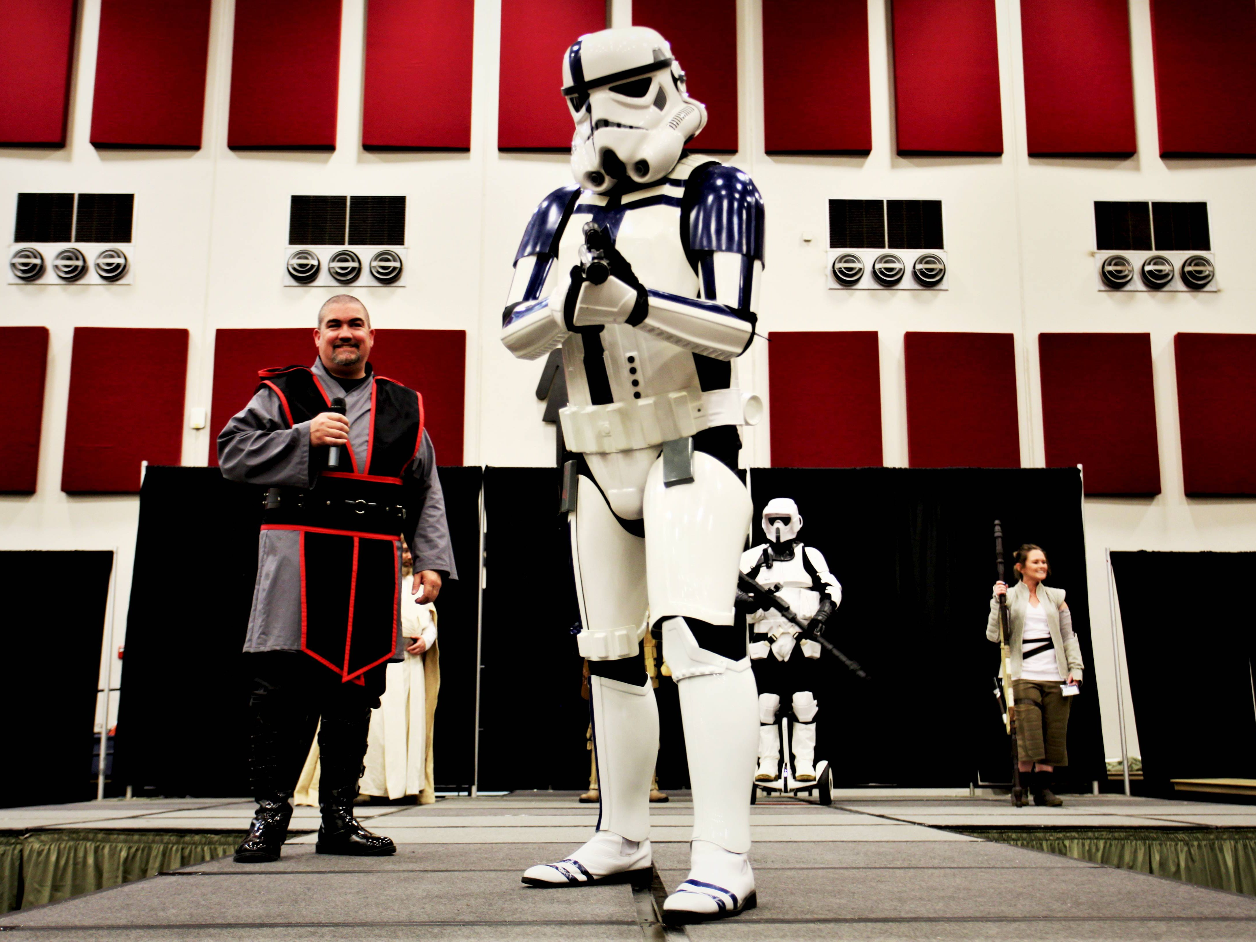 Norm Hackett Jr., left, introduces a stormtrooper at Visioncon May 11, 2019.
