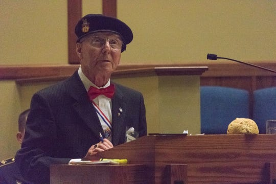 Gunther Skaletz recalls his hardships while imprisoned at Auschwitz. He used a visual aid on the lectern -- a hard, stale piece of bread -- to explain the type of food on which he depended for survival. Skaletz spoke May 2, 2019 at Fort Leonard Wood's Main Post Chapel during an observance of Holocaust Remembrance Day.