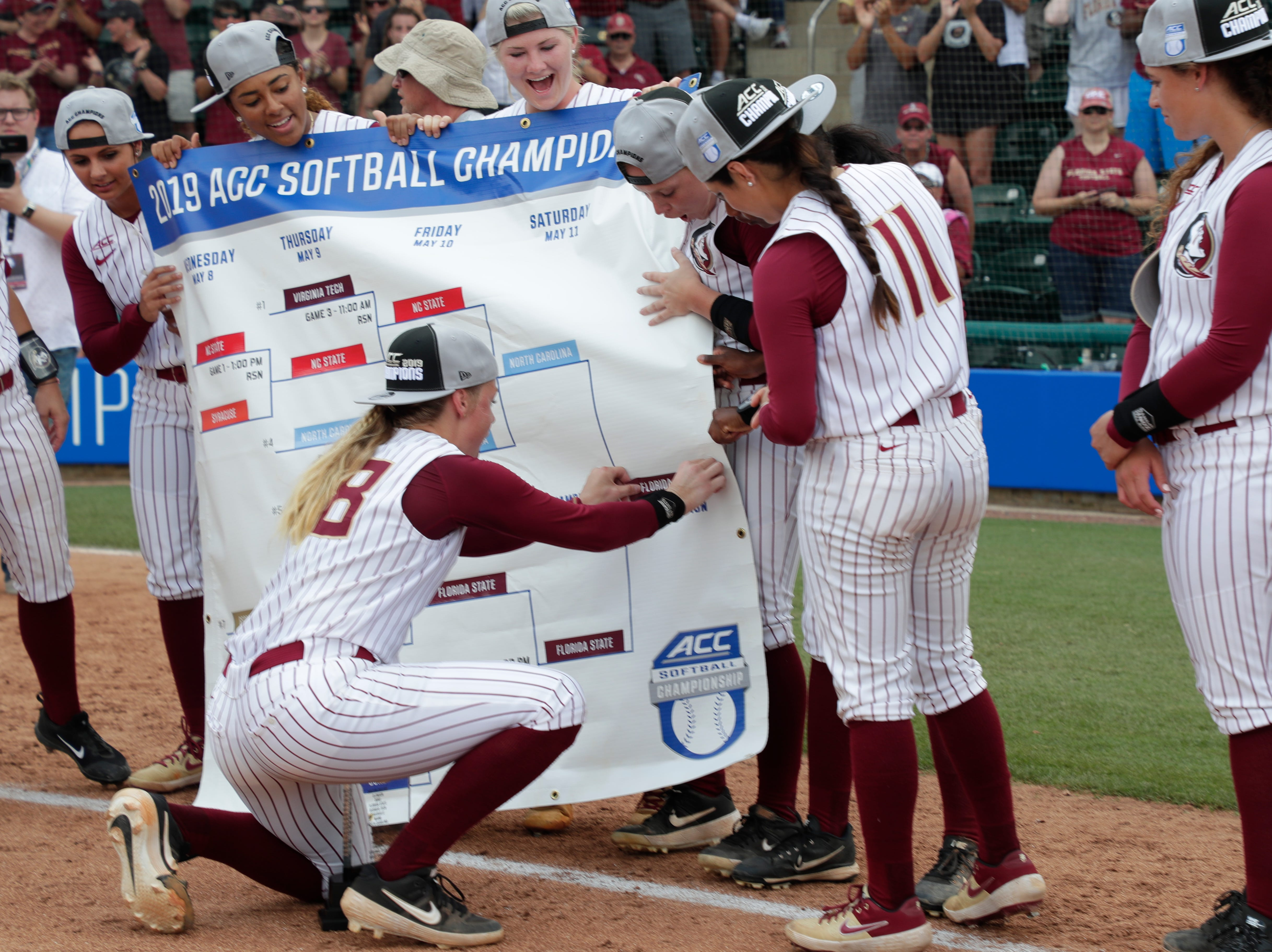 Florida State Seminoles starting pitcher/relief pitcher Meghan King (48) places a sticker showing that Florida State won. The Florida State Seminoles celebrate their victory over the UNC Tar Heels for the ACC Softball Championship title Saturday, May 11, 2019.
